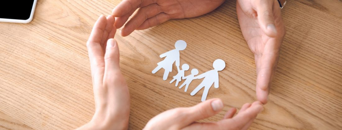 Family paper model on wooden tabletop